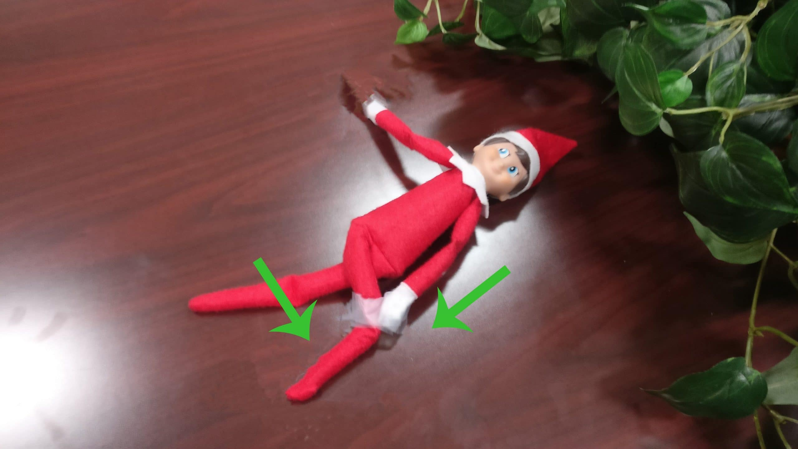 Elf on the shelf doing a trunk rotation stretch.