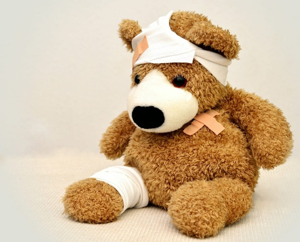 A teddy bear covered in injuries and ready to receive some physical therapy.
