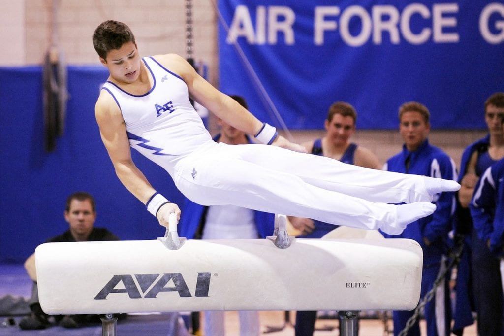 Gymnast trying to maintain balance after receiving vestibular rehabilitation physical therapy.